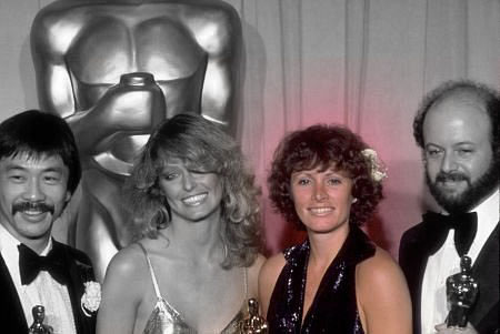 Marcia accepting the Best Editing Oscar at the 1978 Academy Awards, with presenter Farrah Fawcett and co-editors Paul Hirsch and Richard Chew